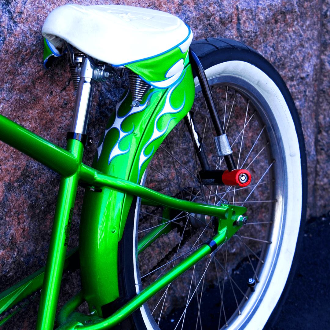 Green Retro Bike Against Granite Wall in Tucson, Arizona